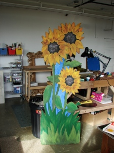 Giant sunflowers painted on recycled kayak box!