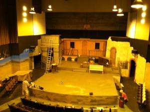 A picture of the stage from the sound booth/balcony.  As you can see lots of the set is getting worked on little by little.