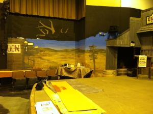 Working on the large-scale mural (20+ feet long x 9 feet high) that depicts the town of Hope Springs.