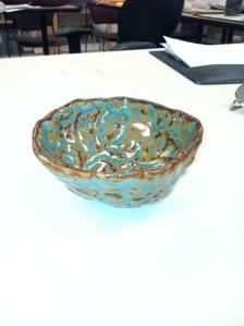 Pinch pot tea bowl with Pat's oil spot glaze on it.