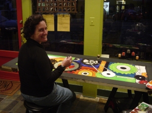 Bridgett Harkings learning to paint with acrylics on a recycled wood door.  2009
