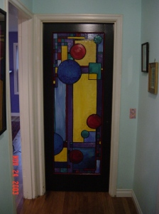 Commissioned door for a client's home.  Inspired by Frank Lloyd Wright's stained glass panels, 2004